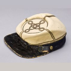 Confederate Regulation 'Yellow' Lieutenants Kepi of George J. Pratt, Company H, 18th Virginia Cavalry. The only known surviving example of a Cavalry Officer's Kepi made of yellow wool per 1862 regulations. Bands of gold bullion quatrefoil for rank of First Lieutenant. Served under General John Imboden from Gettysburg in 1863 to serving with the VMI Cadets in the battle of New Market, and through the Shenandoah Valley campaigns.