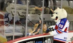 Boomer the Alaska Aces mascot interacts with young fans before the start of the hockey game against the Indy Fuel at Sullivan Arenain 2016. (Bob Hallinen / Alaska Dispatch News)