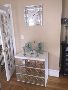 IKEA malm hack with added mirrors and satin nickel overlays in jasmine