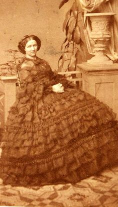 Queen Carola of Saxony, 1860s. I'm sure it's possible to get another ruffle on the dress, but I'm not sure how.