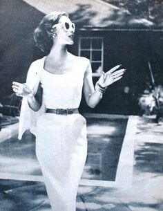 White belted dress with jacket 1950s tiny waist, long nails, big glasses, hairdo