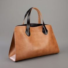 Best 12 Marni Description: Brown leather tote from Marni featuring two contrasting black top handles, four protective metal feet and an interior press stud fastening pocket with a sticthed signature logo tag. Leather Handle, Leather Purses, Leather Handbags, Tote Handbags, Purses And Handbags, Tote Bags, Designer Shoulder Bags, Brown Leather Totes, Shopper