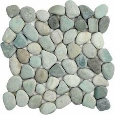"""Natural Green Pebble Tile 12x12"""" by Pebble Mosaics. $10.00. Green. Approx. 3/4"""" - 2"""". Approx. 1/2"""". Beach pebbles, naturally tumbled by the sea, are used to create our Seaside pebble tile line. Each stone for these mosaic pebble tiles are hand selected and adhered to a mesh backing for easy installation. Our unique interlocking system gives the appearance that each stone is hand set."""