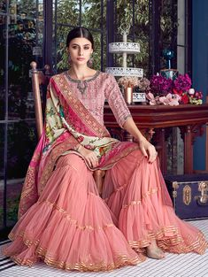Baby Pink Multi Embroidered Lucknowi Gharara Palazzo Suit has very intrinsic designer lucknowi embroidery over its satin silk top paired with matching ghera embroidered net gharara palazzo bottom a. Pakistani Bridal Dresses, Indian Dresses, Indian Outfits, Pakistani Clothing, Gharara Designs, Diwali Dresses, Trendy Suits, Sharara Suit, Anarkali Suits