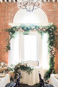 www.littlehillfloraldesigns.com  sweetheart table, wedding arch, bride and groom, centerpiece, greenery, purple wedding flowers, ceremony arch, wedding inspiration, wedding inspo, luxury wedding #purplewedding #weddingceremony #weddinginspiration #weddingcenterpieces