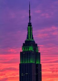 The @Empire State Building glows green today at sunset. #NYC via @isardasorensen