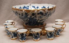 Haviland Limoges hand painted punch bowl and 10 cups, bowl is 9h x 13dia