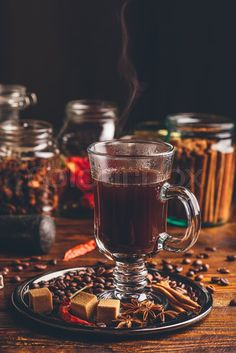 Stock image of 'Glass of Coffee with Steam. Coffee Grains, Refined Sugar, Star Anise, Cinnamon Stick and Chili Pepper on Tray. Coffee Facts, Coffee Signs, Tea Sandwiches, Coffee Shop Music, Turkish Coffee Reading, Coffee Grain, Spiced Coffee, Cinnamon Coffee, Green Coffee Bean Extract