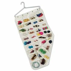 """Offering essential storage for your baubles and bangles, this versatile jewelry organizer features 80 clear pockets and aluminum hanger.   Product: Jewelry organizerConstruction Material: Aluminum and cotton-polyester blend fabric Color:  Clear and white Features:  Takes up less than 2"""" of closet spaceDouble-sided storage with 80 clear pocketsIncludes aluminum hanger Dimensions: 35"""" H x 18"""" W"""