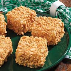 When I was in high school, I worked for an Irish family.and they made these yummy treats each year for St. The sweet frosting and salty peanuts Just Desserts, Delicious Desserts, Dessert Recipes, Yummy Food, Dessert Ideas, Yummy Recipes, Dessert Bars, Cheesecake Recipes, Gastronomia