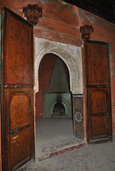 The Marrakech home of Talitha Getty's designer. The iconic fluted abysinthe coloured tadelakt and brick fireplace in the master bedroom in the Bill Willis home - Dar Noujoum. Marrakech, Palace, Tadelakt, Brick Fireplace, Moorish, North Africa, Home Decor Styles, Arches, Foyer