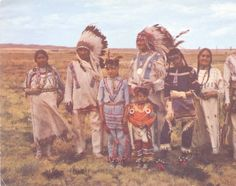 Chief Bull stands among seven Blackfoot Indians in field :: MS 320 Paul Dyck