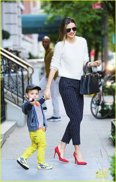 Miranda Kerr and her son Flynn step out of their apartment in New York City on October 18, 2013