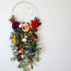 Its hard to find words to even describe this piece!!! It truly just makes my heart skip a beat and makes me feel like Im in an enchanted garden when Im near it!! The base is a gold 10 hoop with a cream string, hand woven web, holding 9 specialty beads cascading down the right side.