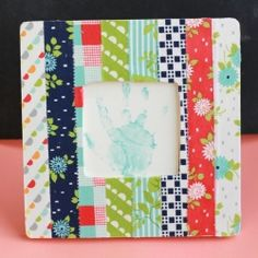 Dress up a $1 frame with fabric scraps   love it mean it