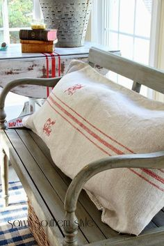 Living Room decor - rustic farmhouse style. Fall Around the Sunroom - that grain sack pillow is fabulous!