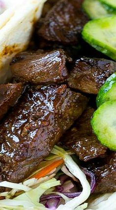 This recipe for Korean BBQ Tacos is marinated and seared beef layered with cabbage slaw and marinated cucumbers, all tucked into warm flour tortillas. Korean Dishes, Mexican Dishes, Mexican Food Recipes, Beef Recipes, Dinner Recipes, Cooking Recipes, Korean Bbq, Korean Food, Tacos And Salsa