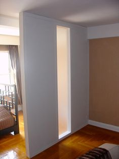 Install a room divider kit or build an expensive wall for Temporary bedroom walls