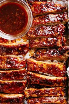 Oven Barbecue Ribs slathered in the most delicious sticky barbecue sauce with a. , < Oven Barbecue Ribs slathered in the most delicious sticky barbecue sauce with a kick of garlic and optional heat! Juicy melt-in-your-mouth oven bake. Oven Pork Ribs, Sticky Pork Ribs, Ribs Recipe Oven, Baked Bbq Ribs, Barbecue Pork Ribs, Beef Ribs, Barbecue Sauce, Pork Rib Marinade, Best Ribs In Oven