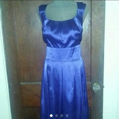 """London times royal blue satin dress This is an amazing dress and it brakes my heart to let it go. But it's just to big in the chest area for me so it's time to pass on the awesome this is a royal blue mid caff, (I'm 5.5"""") satin dress by London times  Its in excellent condition with only a minor flaw and that's a snag in the tie backs. It is a size 18W.  Soft nylon lining and zips and latches in back. From a smoke free home Pet friendly home Price is firm London Times Dresses Asymmetrical"""