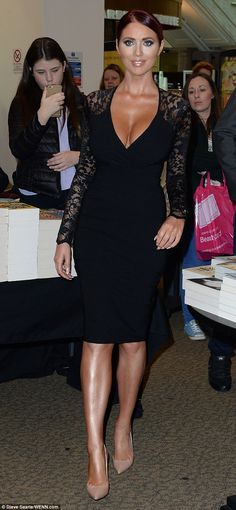 Style rebel: Amy Childs ripped up the rule book and flashed both her ample assets and lean legs in a plunging lace dress as she attended a book signing in Manchester on Saturday