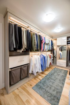 Separating different type of clothing into sections to create an organized space, makes it easy to find what you need. Also notice the lighting, which helps to illuminate the space. Custom Walk In Closets, Walk In Closet Design, Bedroom Closet Design, Closet Designs, No Closet Solutions, Storage Solutions, Aluminium Sliding Doors, Shoe Shelves, Modern Closet