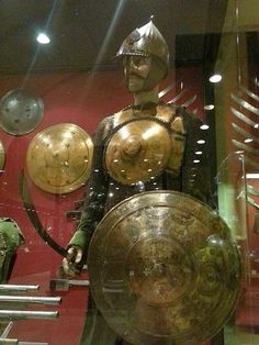 Ottoman tombak (gilded copper) krug cuirass and kalkan shields, Grand Palace Armoury, Malta.