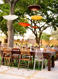 Vintage mix of umbrella and various type seating for a whimsical feeling. wedding by JCG events