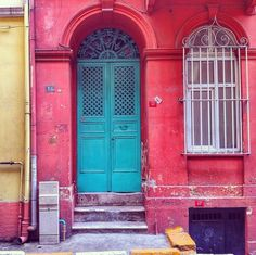 A harmony of colors: A turquoise door and a window with white ornamented fence in Tarlabaşı, İstanbul.