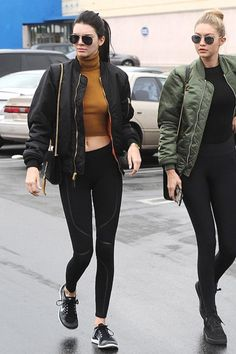 Kendall Jenner wearing Saint Laurent Classic 11 Aviator Sunglasses, Saint Laurent Monogramme Small Suede Cassandre Bag, Yeezus Bomber Tour Jacket and Nike Free 4.0 Flyknit Sneakers in Black/Wolf Grey/Dark Grey/White