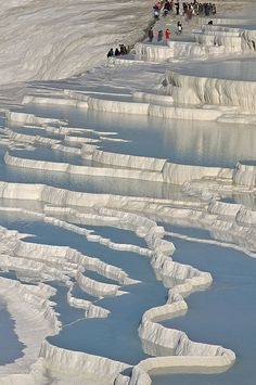 Pamukkale, Turkey - incredible place- the  terraces are made of travertine, a sedimentary rock deposited by water from the hot springs.