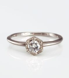 Actually, this at .33ct & 18k rose gold ($3160) would be an amazing ring.  Note to all present and future boyfriends.