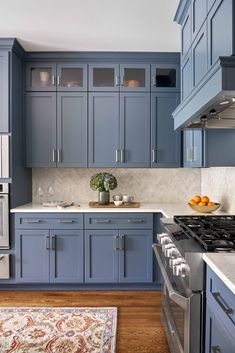 Soft blue cabinets with grey undertones make this kitchen from Beth Haley Design a stunner. Kitchen Room Design, Modern Kitchen Design, Home Decor Kitchen, Interior Design Kitchen, Home Kitchens, Blue Kitchen Ideas, Dark Blue Kitchen Cabinets, Blue Gray Kitchen Cabinets, Kitchen Island With Cooktop
