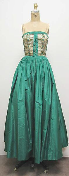 Green silk evening dress with matching wrap and shoes, by Madame Grès (Alix Barton), French, ca. 1959. Dress bodice is embroidered with metal thread, glass beads, and rhinestones.