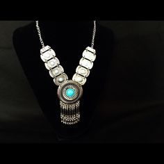 SILVER ROUND PENDANT NECKLACE WITH TASSELS Pretty & Aztec Inspired Silver tone Pendant Necklace. It features a round Turquoise shade pendant & stone with silver tone tassels. So trendy! 48 cm chain plus 5 cm adjustable, 10 cm pendant. Comes in vendor bag. No trades. Jewelry Necklaces