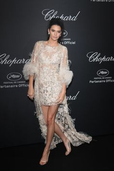 Kendall Jenner wearing a vintage-style lace dress in Cannes.
