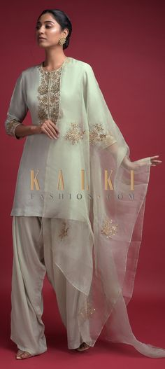 Buy Online from the link below. We ship worldwide (Free Shipping over US$100)  Click Anywhere to Tag Cucumber Green Dhoti Suit In Cotton Silk With Zardozi Embroidered Floral Pattern Online - Kalki Fashion Cucumber green dhoti suit in cotton silk.Adorned with zardozi, sequins and zari embroidered floral pattern on the neckline.