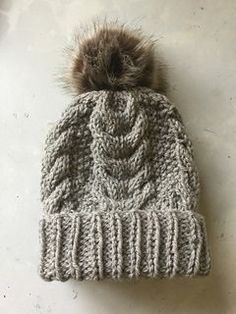 A free knit pattern Snug fit cabled beanie hat with a ribbed double cuff hem. A great essential for Men and Women and super cute on kids. One size fits most and is easily adapted. This is a quick knit, worked on big needles with chunky yarn. Jo x