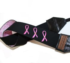 Camera strap with pink ribbon embroidered on it...cool.