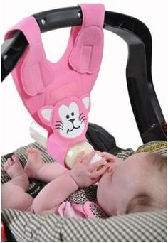 9.This bottle sling attaches to the car seat and offers an extra hand during bottle feedings.