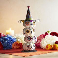 These stacked Day of the Dead pumpkins are sure to play nicely with all your favorite holiday decorations. Find the perfect spot for them and infuse your Halloween with glittery sparkle and eerie charm.