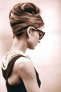 Audrey Hepburn.  Pearls and over-sized sunglasses.  Always a classic.
