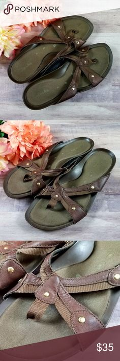 CLARKS Crossover Thong Sandals Slides Flip Flips CLARKS Comfort Brown Crossover Thong Sandals Slides Flip Flips Size 7.5  Cute flip flops with Clark's comfort! Great condition.  Thank you for looking and please check out my closet! Clarks Shoes Sandals