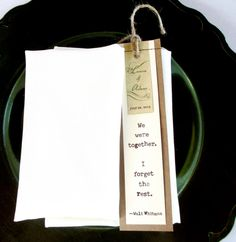 "Bride and Groom/English Teachers Handstiched Bookmark Favors  placed at each place setting. ""we were together...i forget the rest.""   Walt Whitman  Laura & Adam 