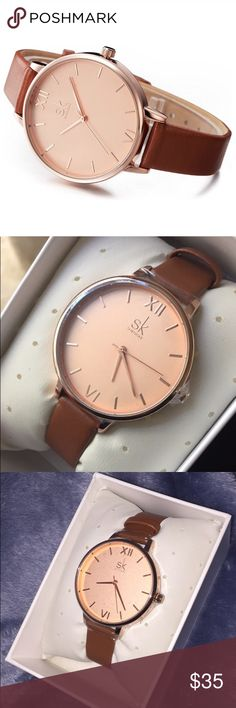 """• Casual Brown Wristwatch • trendy, stylish, and chic watch • big rose gold face with gold accents  • Roman numerals  • brown leather band • total band length 8.7"""" • adjustable strap • battery included • will come with nice storage box & pillow        • B U N D L E  &  S A V E ! •     💌 I do not ship on Tuesdays or Thursdays 📦 Please allow up to 3 days for me to ship 💌 Fridays & Saturdays may vary Accessories Watches"""