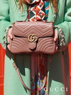 From Gucci Cruise 2018, new GG Marmont top handle bags feature a softly structured shape and an oversized flap closure with Double G hardware by Alessandro Michele.