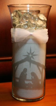 I created this using Glass Etch Vinyl and the nativity file by Lori Whitlock using the Silhouette Cameo.