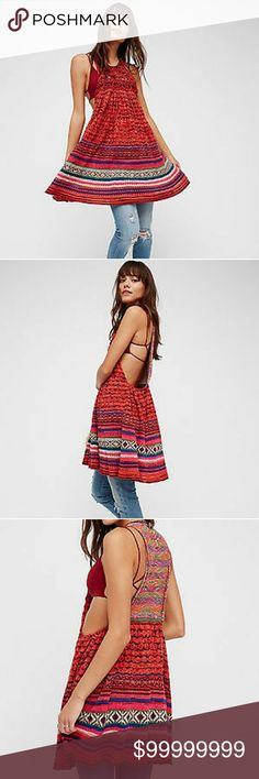 """*COMING SOON*FREE PEOPLE RARE HEART SWEATER TUNIC 'Rare Heart' multi-hued ruffled knit tunic with a bohemian feel rendered in a woven texture features a too cute seasonal print and an easy, flared shape.Detailed with a pleated front and back, ruffled hi-lo hem, low dipped sides, gathered seam detail, crew neck, sleeveless with back cutout design and button-and-loop closure. Approx. 32"""" length....51% cotton, 41% rayon, 6% wool, 2% nylon.  Perfect for wearing as a dress or as a layering top…"""