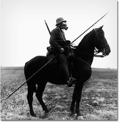 He's actually a German soldier in World War I, back when the transition from horse to tank still wasn't fully complete. However, while we have to question the effectiveness of using a lance to take on machine guns, the psychological effect of charging the enemy with a sharp stick in a gas mask from atop a black steed can't be underestimated.
