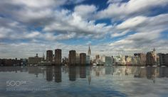 Manhattan From Brooklyn by DomiRchx  sky city sunset water downtown reflection river travel buildings clouds urban architecture cityscape